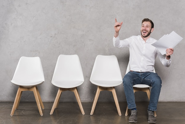 Front view of happy man waiting for his job interview Premium Photo