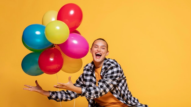 Front view of happy woman with balloons Free Photo