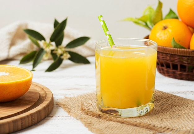 Front view healthy homemade orange juice Free Photo