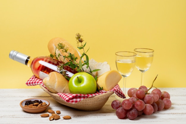 Front view healthy picnic goodies on wooden table Free Photo