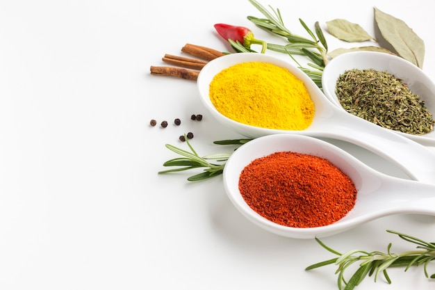 Front view herbs and powder spices Free Photo