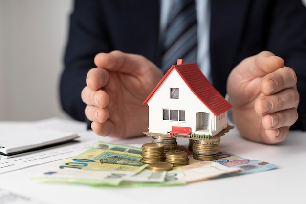 Front view house investments elements arrangement Free Photo