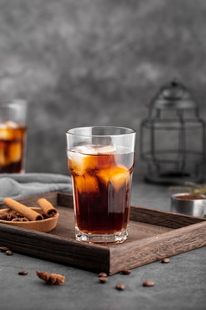 Front view iced coffee glass on wooden board Free Photo
