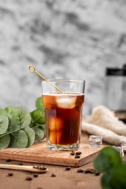 Front view iced coffee on wooden board Free Photo