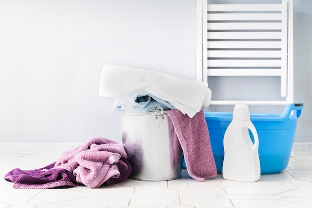 Front view laundry baskets with detergent Free Photo