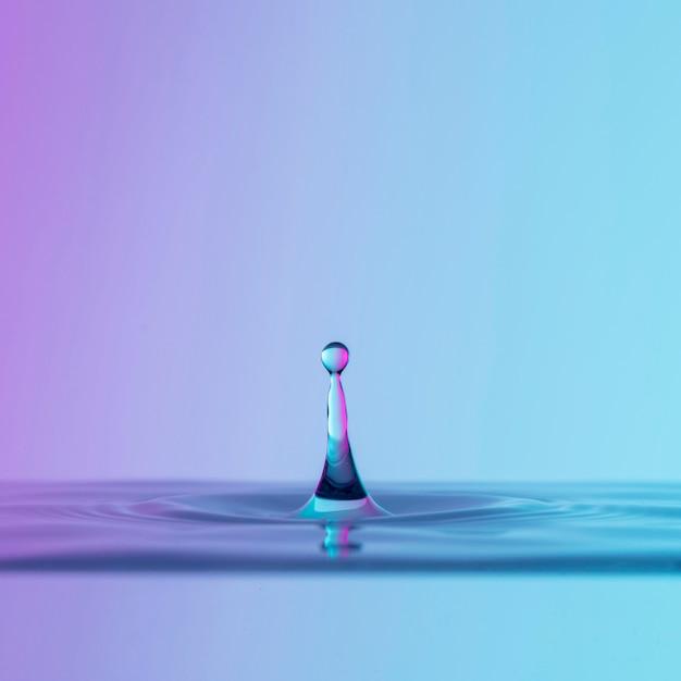 Vista frontale del liquido con goccia Foto Gratuite