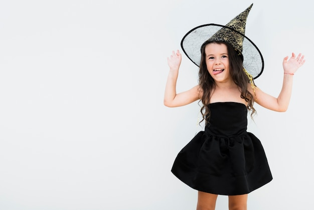 Front view little girl in witch costume with copy space Free Photo