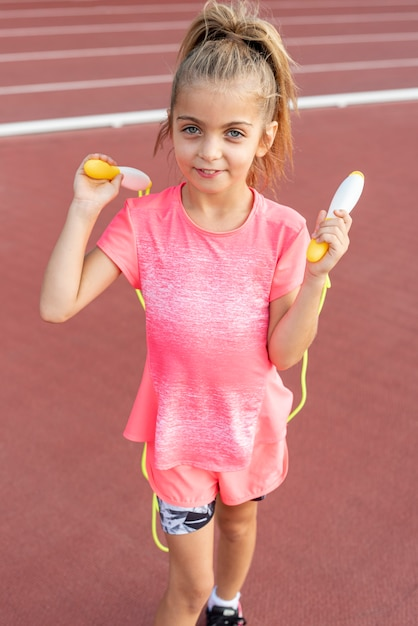 Front view of little girl with jumping rope Free Photo
