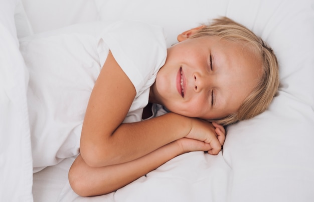 Front view little kid having sweet dreams Free Photo