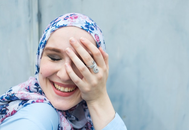 Front view of lovely woman with hijab Free Photo