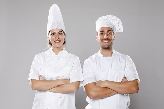Front view of male and female chefs Free Photo