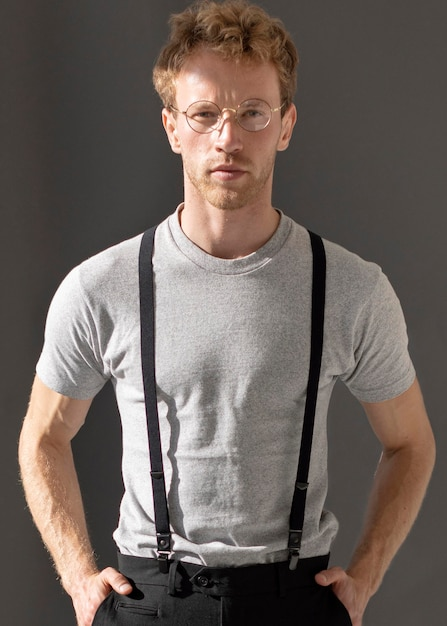 Front view male model wearing suspenders accessory Free Photo