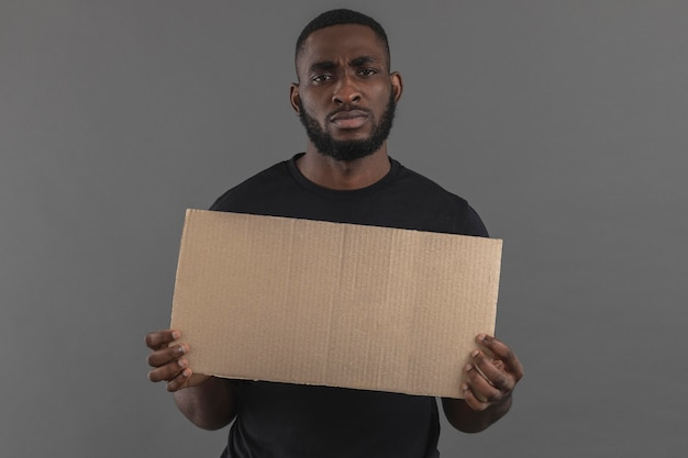 Front view man holding copy space paper Free Photo