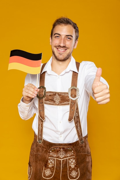 Front view of man holding german flag Free Photo