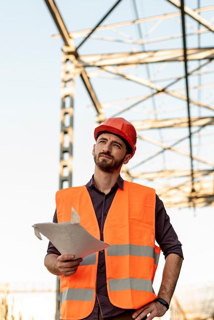 Front view of man holding plan Free Photo