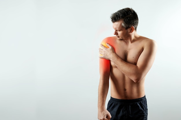 Front view, the man holds his hands to the forearm Premium Photo