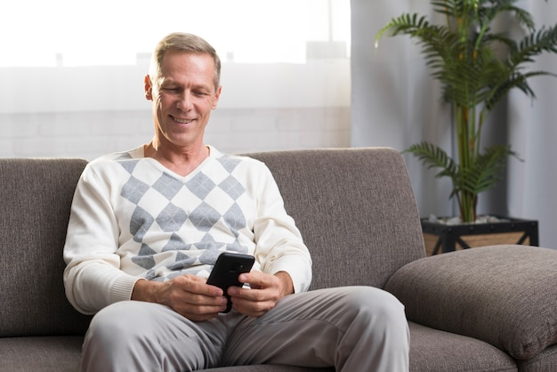Front view of man sitting on couch Free Photo