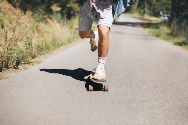 Front view of man skateboarding Free Photo