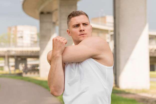 Front view man stretching Free Photo