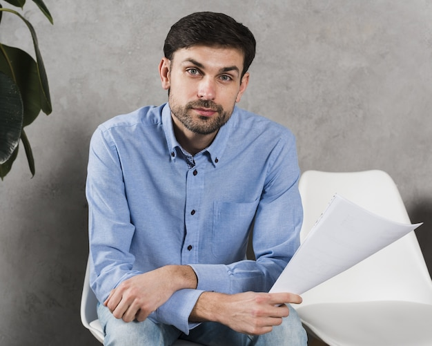 Front view of man waiting for his job interview Free Photo