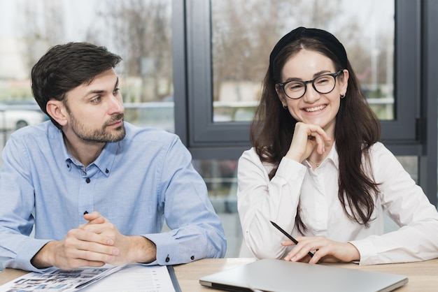 Front view of man and woman attending a job interview Free Photo