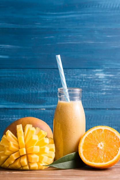 Front view mango and orange smoothie Free Photo