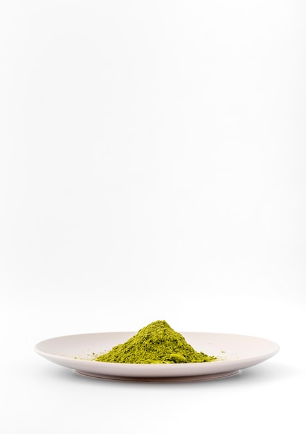 Front view matcha tea powder on a plate Free Photo