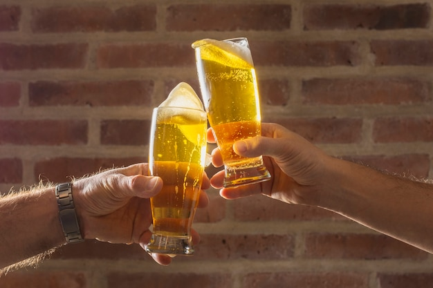 Front view men cheer with beer glass Free Photo