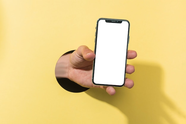 Front view mockup smartphone held by person Free Photo
