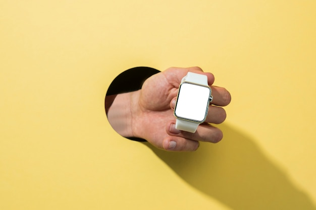 Front view mockup smartwatch held by person Free Photo