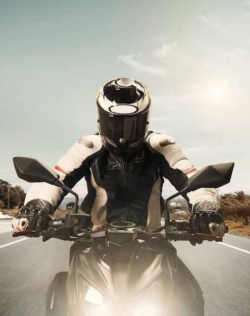 Front view of motorcyclist speeding up Free Photo
