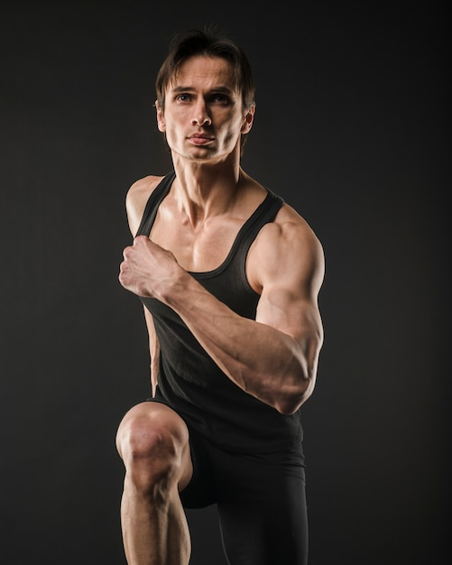 Front view of muscly man running Free Photo