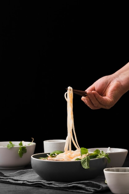 Front view of noodles in bowl with copy space Free Photo