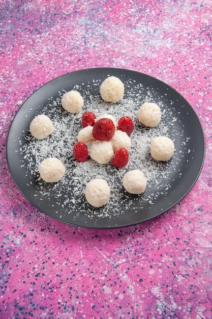 Вид спереди вкусных кокосовых конфет Бесплатные Фотографии