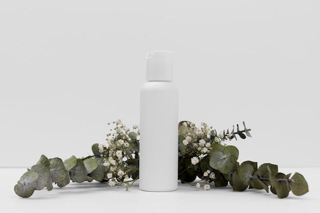 Вид спереди концепции бутылки эфирного масла Бесплатные Фотографии