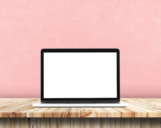 Вид спереди ноутбука находится на рабочем столе, красочный фон. Premium Фотографии