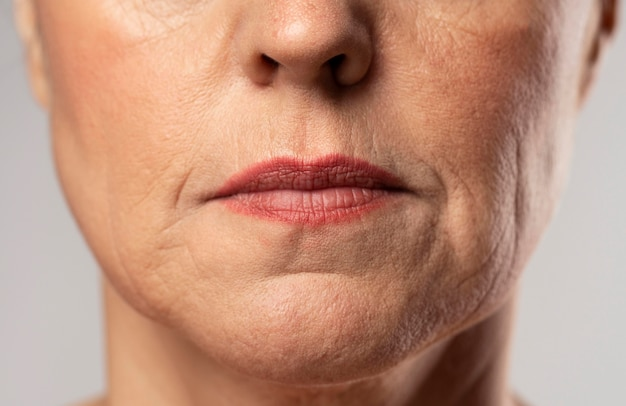 Front view of older woman posing stoic with make-up on Free Photo