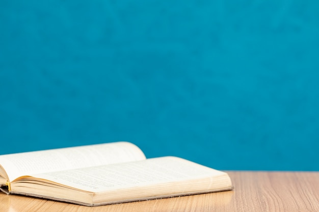 Front view open book on wooden table Free Photo