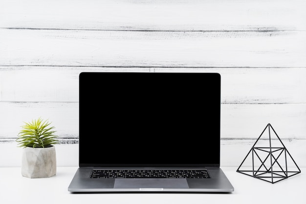 Front view opened laptop and desk decor Free Photo