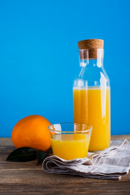 Front view orange juice bottle and glass Free Photo