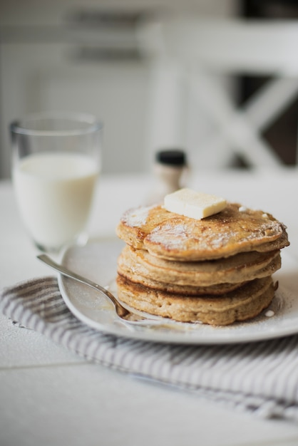 Front view pancakes with milk Free Photo