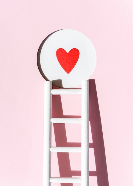 Front view of paper heart with ladder Free Photo