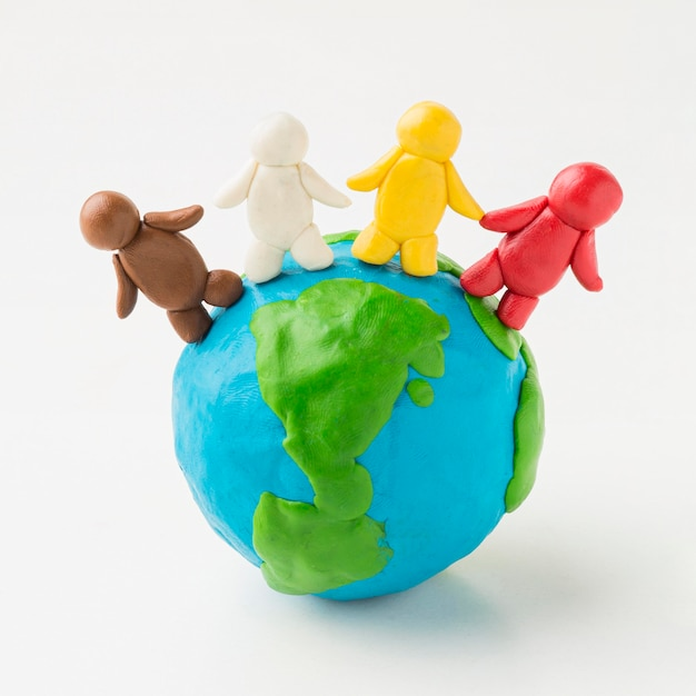 Front view of plasticine earth globe with people Free Photo