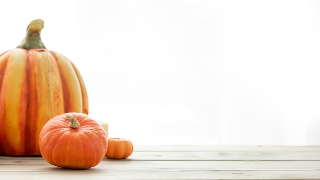 Front view pumpkins on wooden table with copy space Free Photo