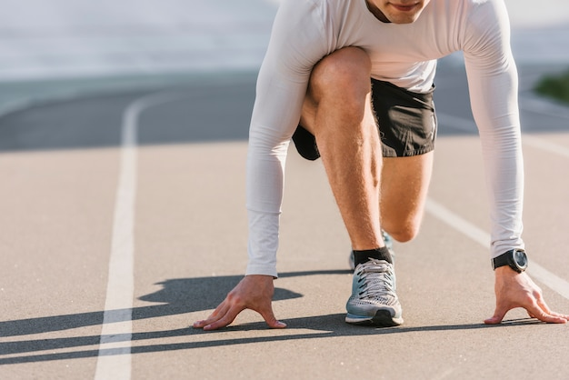 Front view of runner in starting position Premium Photo