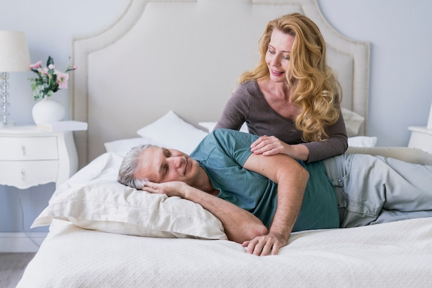 Front view senior man and woman in bed Free Photo