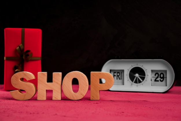 Front view of shop word on plain table Free Photo
