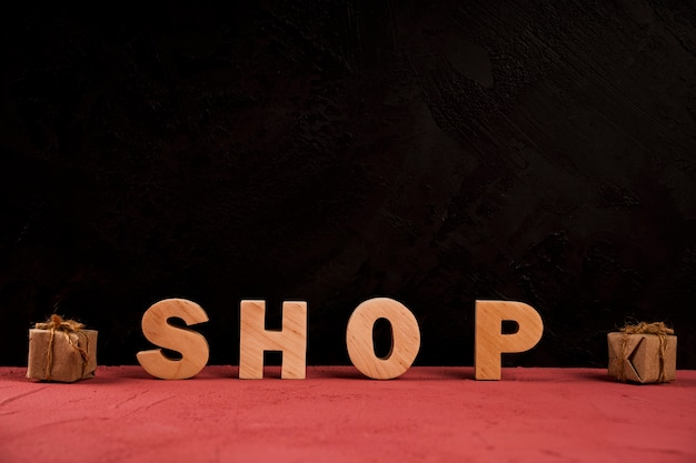 Front view of shop word on red table Free Photo