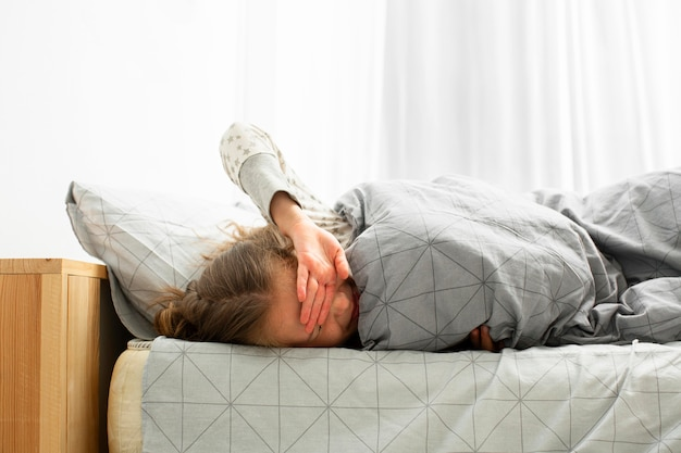 Front view of sleeping girl waking up Free Photo