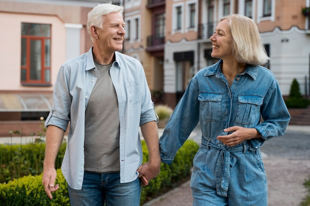 Front view of smiley older couple in the city Free Photo